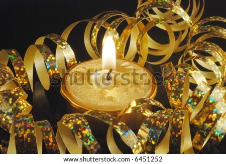 christmas gold candle and gold ribbon