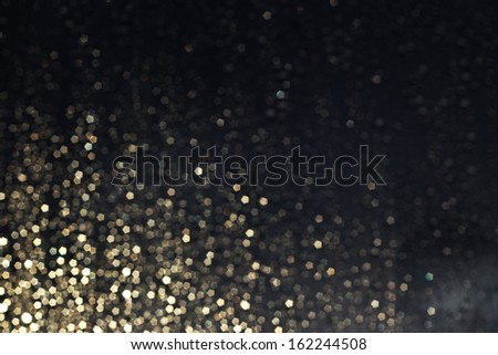 Christmas gold light bokeh in the corner on dark blue background - stock photo