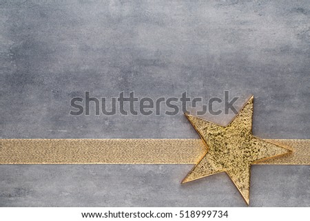 Christmas gold stars. Christmas pattern. Background on the gray color.