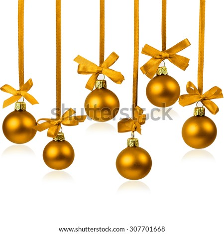 Christmas golden balls with ribbons with space for your text isolated on white - stock photo