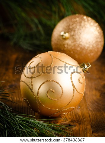 christmas golden bauble on wooden background