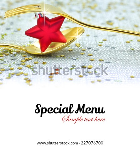 Christmas golden cutlery and on festive background - stock photo