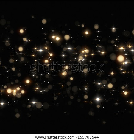 Christmas golden glitters on black background - stock photo