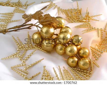 Christmas golden grapes decoration with a candle lighting