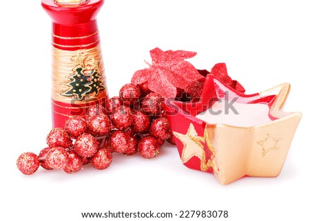 Christmas grapes decoration and candles isolated on white background. - stock photo