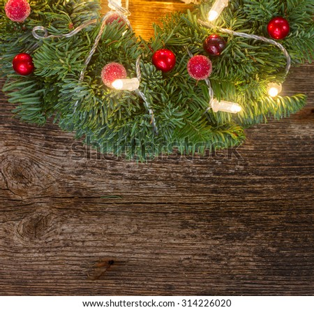 christmas green wreath with lights, copy space  on wooden table  - stock photo