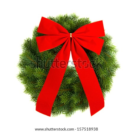 christmas green wreath with red ribbon over white background, isolated - stock photo
