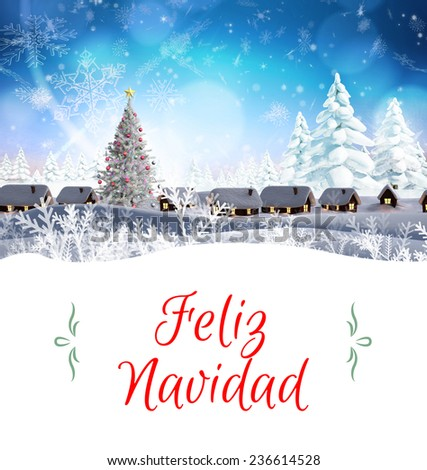 Christmas greeting card against snow covered village - stock photo