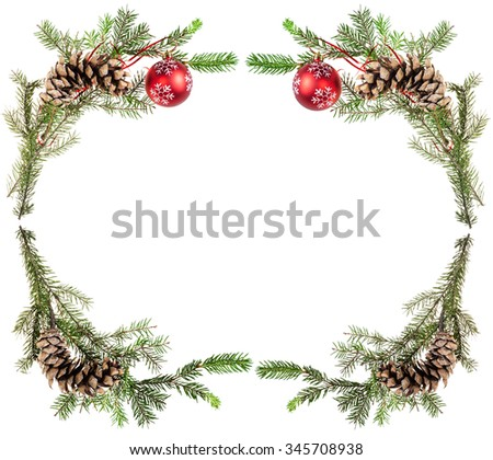 christmas greeting card frame - spruce tree twigs with cones and red balls on white background - stock photo