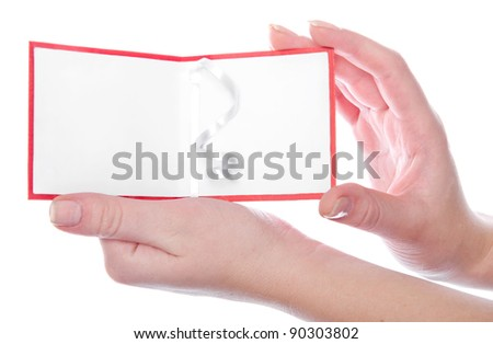Christmas greeting card in woman's hands. Place for your text. Isolated on white