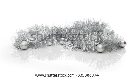 Christmas greeting card made of silver tinsel with silver christmas balls, copy space - stock photo