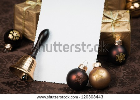 Christmas greeting card with brown Christmas balls, presents and bell