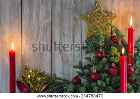 Christmas greeting card with candles and a copy space for text on a wooden background - stock photo