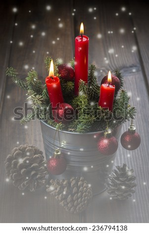 Christmas greeting card with candles over a wooden background and a magical atmosphere - stock photo