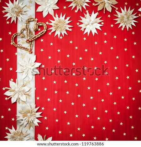 Christmas greeting card with Christmas decorations on a red background with stars