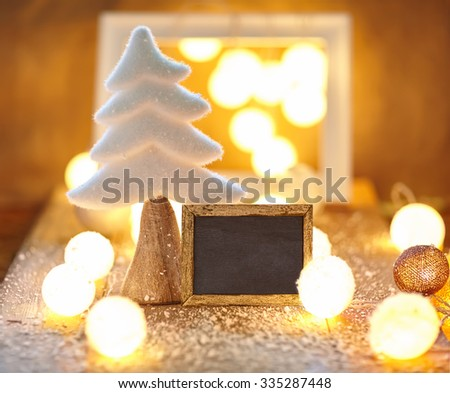 Christmas greeting card with empty chalkboard - stock photo