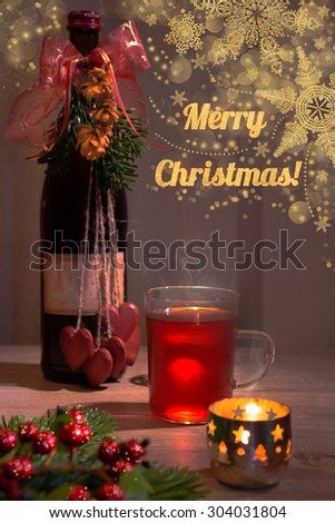 "Christmas greeting card with mulled wine on the table and seasonal decorations, text ""Merry Christmas!"" - stock photo"