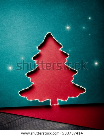 Christmas greeting card with xmas tree paper cutout, with digital effects - sparkles - added. Plenty of space for text. Simple duotone composition.