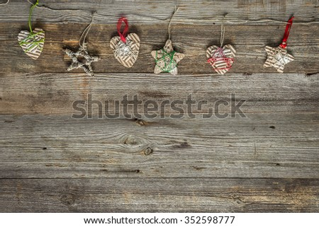 christmas handmade decorations on old wooden background with text space