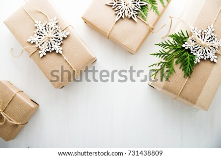 Christmas handmade gift boxes decorated craft stock photo image christmas handmade gift boxes decorated with craft paper and white snowflakes on white wooden background top negle Image collections