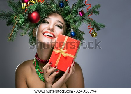 christmas happy woman over gray background - stock photo
