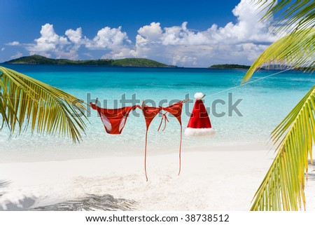 christmas hat and red bikini on tropical beach - stock photo
