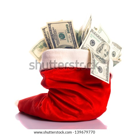 Christmas hat full of $100 dollar bill isolated on white - stock photo