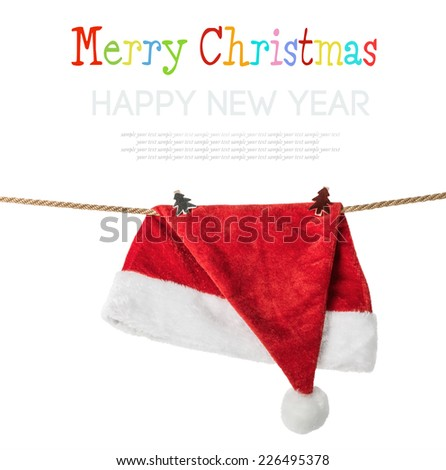 Christmas Hat Santa claus hanging on a rope with clothespins.  - stock photo