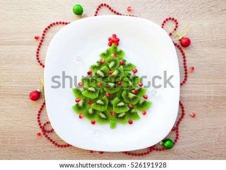 Chocolate sandwich pomegranate marshmallow santa hat stock for Decoration kiwi