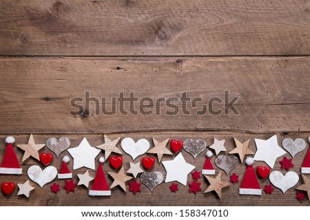 Christmas heart and stars decoration as border or frame on wooden background - stock photo