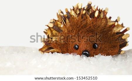 Christmas hedgehog on white snow - stock photo