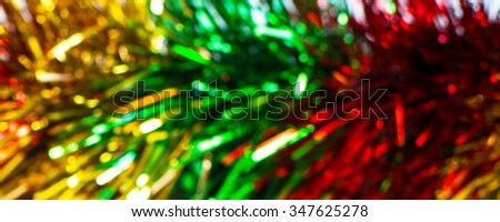 Christmas holiday abstract background with defocused glitter red, yellow, green decorations - stock photo