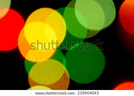 Christmas holiday background from color unfocused lights