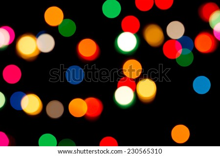 Christmas holiday background of sparkling colorful defocused lights - stock photo