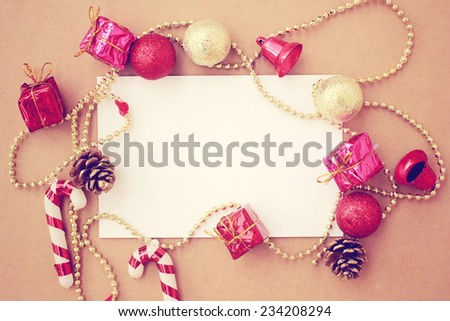 Christmas holiday background with blank greeting card and Christmas decorations, retro filter effect - stock photo