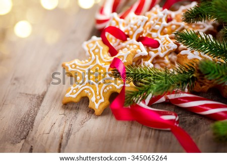 Christmas Holiday background with Candy Cane and Gingerbread Cookies over wooden table