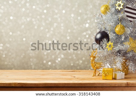 Christmas holiday background with Christmas tree and decorations on wooden table. Black, golden and silver ornaments - stock photo