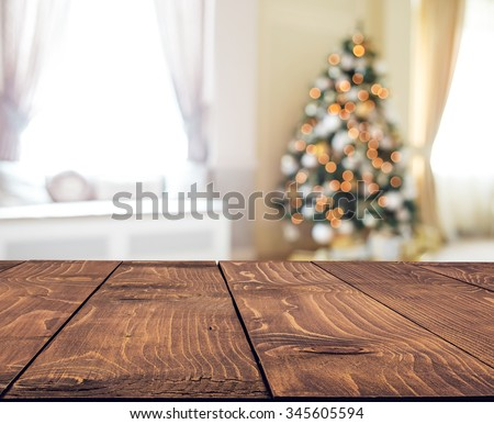 Christmas holiday background with empty rustic table - stock photo