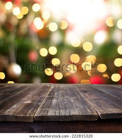 Christmas holiday background with empty rustic table over christmas bokeh for product montage - stock photo