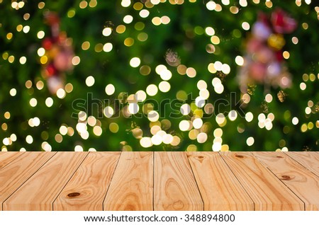 Christmas holiday background with empty wooden deck table over festive bokeh. Ready for product montage. - stock photo