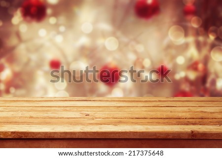Christmas holiday background with empty wooden deck table over winter bokeh. Ready for product montage - stock photo