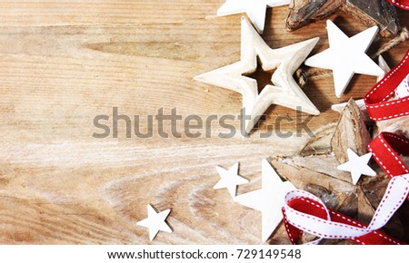 Christmas holiday background with wooden stars