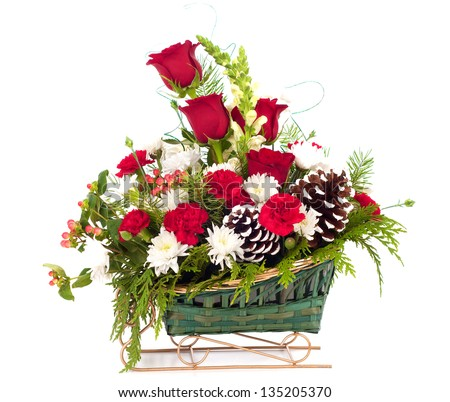 Christmas Holiday Bouquet of Flowers in a Sleigh Basket on white background - stock photo