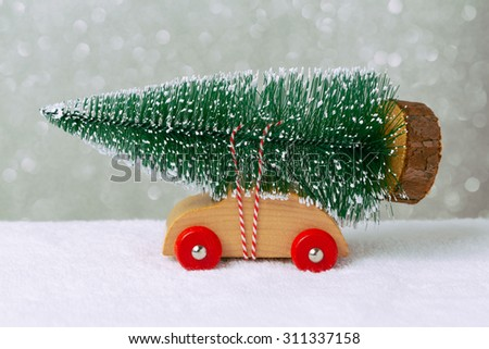 Christmas holiday concept with pine tree on toy car - stock photo