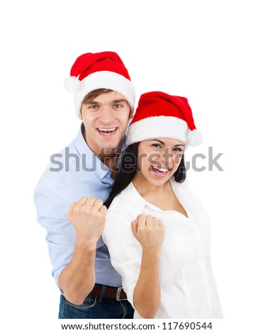 christmas holiday couple excited happy smile hold fist yes arm hand gesture, isolated over white background - stock photo