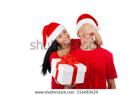 christmas holiday couple happy young woman surprise boyfriend cover his eyes, female covering mans eyes, excited smile, isolated over white background wear red new year hats and shirts