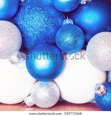 Christmas holiday decoration. Blue and white ornament bauble in the box background. Festive merry xmas, new year celebration. Golden shiny light decorative  ball.