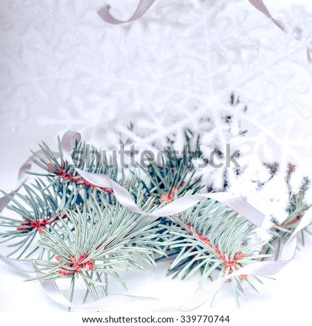Christmas holiday decoration. Brunch of fir, pine tree with gold snowflakes and ribbon. Festive merry xmas, new year celebration. Golden shiny light decorative closeup toys  - stock photo