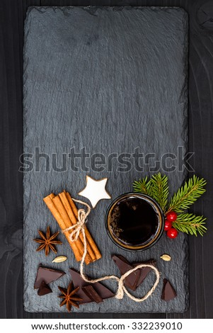 Christmas holiday drink. Spicy hot chocolate with anise and cinnamon. Free text copy space background - stock photo