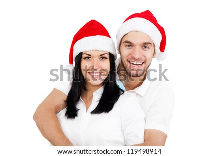 christmas holiday happy couple wear red new year santa hat cap, man and woman love smile looking at camera embracing, isolated over white background - stock photo